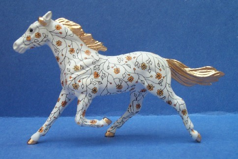 Here's one of Ellen's hand painted horses. Sweet Huh?